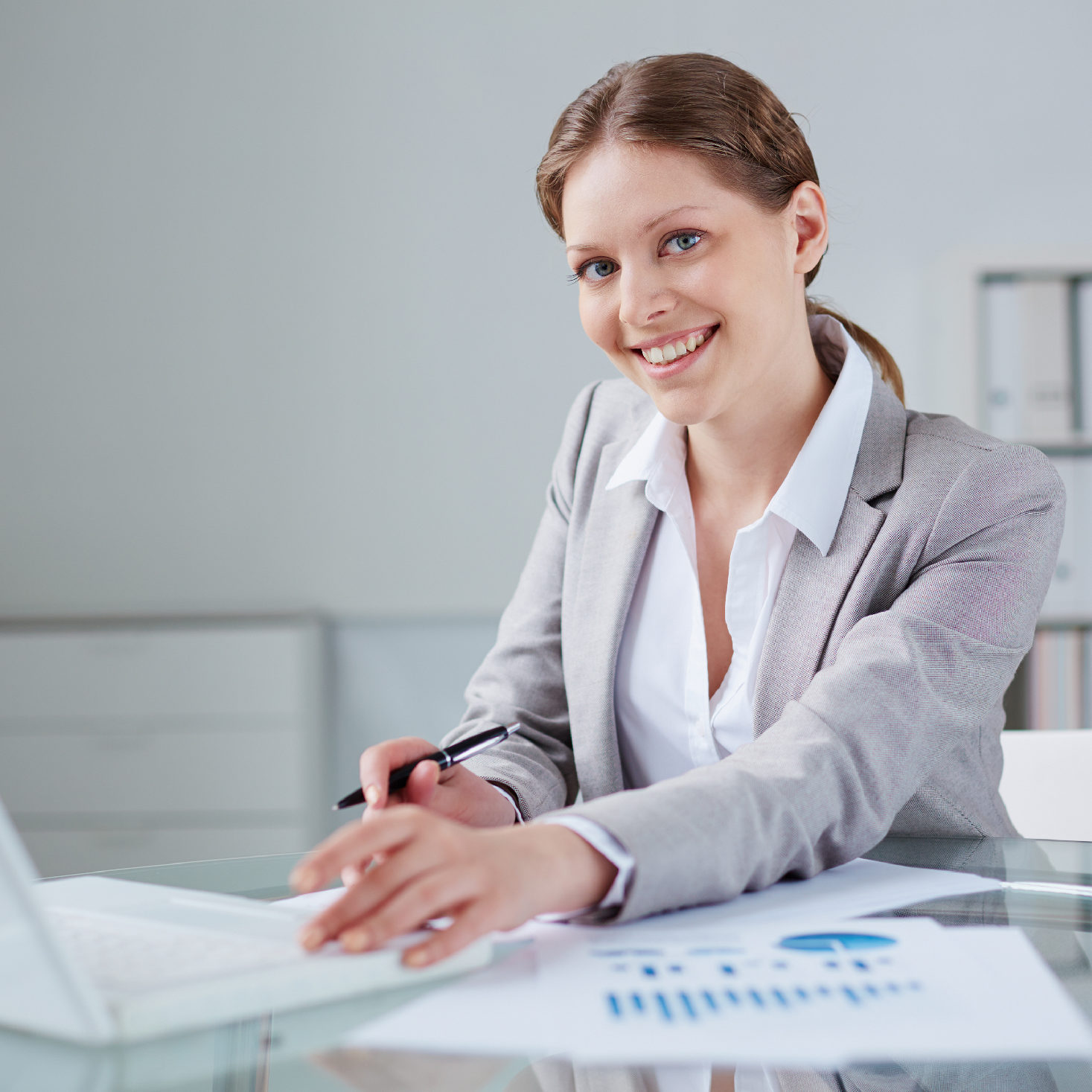 Young businesswoman working in office